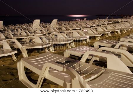 Deck Chairs In The  Moonlight