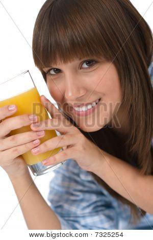 Female Teenager With Healthy Orange Juice