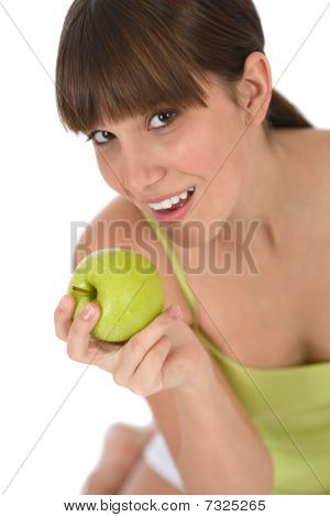 Happy Female Teenager With Healthy Apple