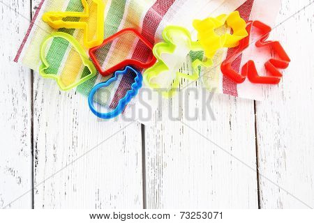 Molds for cutting on color wooden background