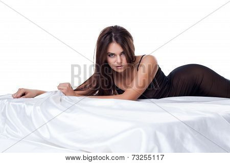 Brown-eyed model in negligee posing at camera