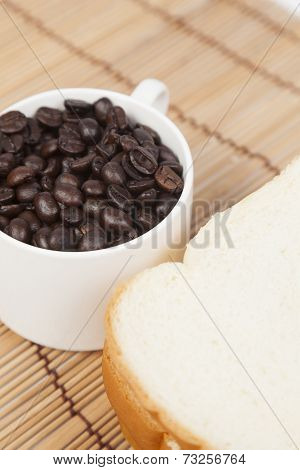 Bread Plate And Cup With Coffee Beans.