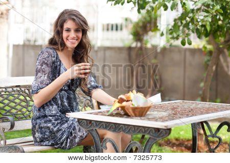 Young Woman Having Breakfast Outside