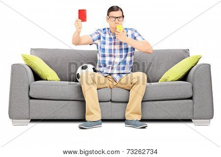 Angry man blowing a whistle and holding a red card isolated on white background