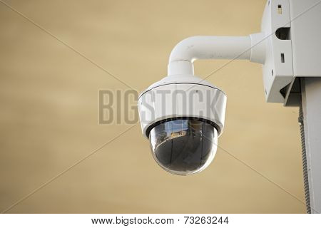 Closeup of a surveillance camera.