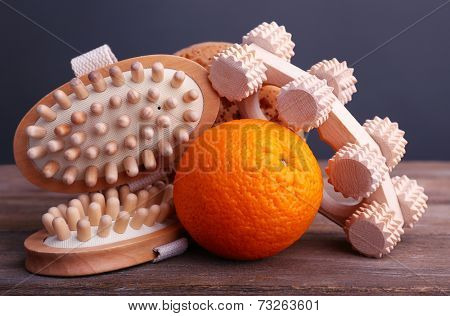 Roller brush, orange and oval brushes on wooden table