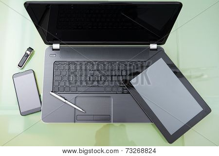 Laptop With Tablet And  Smart Phone On Glass Table