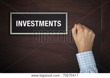 Hand Is Knocking On Investments Door
