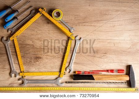 different tools on the wood plank, construction background