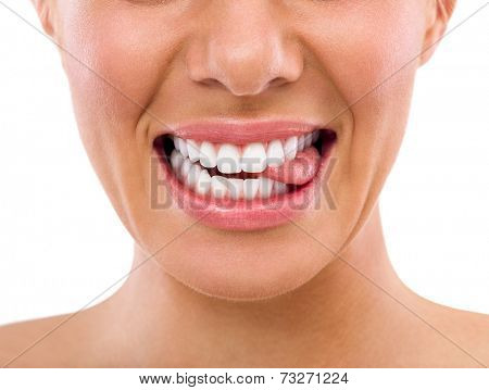 Female biting tongue with perfect white teeth