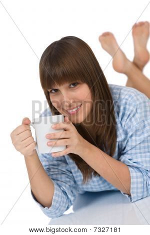 Smiling Female Teenager With Cup Of Tea