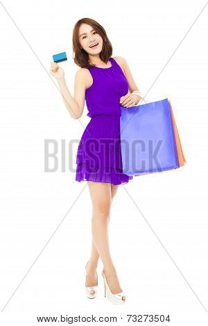 Beautiful Young Woman Holding A Card And Shopping Bags
