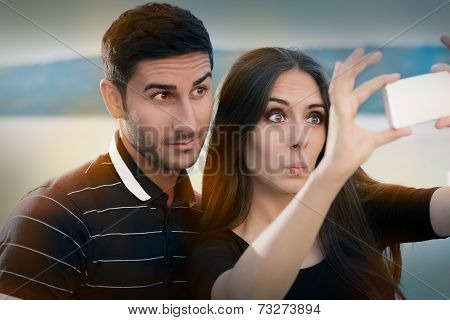 Young Couple Taking a Funny Selfie Together
