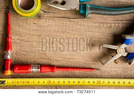 different construction tools  on wooden background