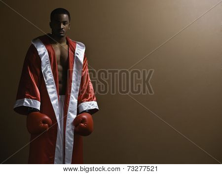 African American man wearing boxing gloves