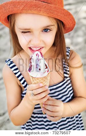 Cute Toddler Girl Eating Ice-Cream