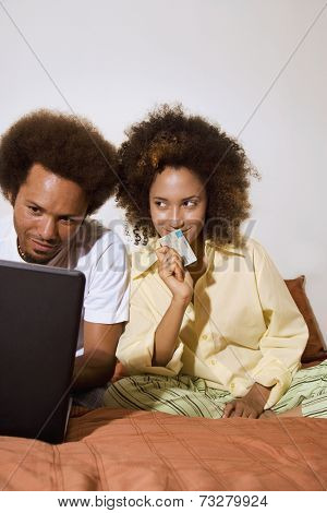African couple shopping online