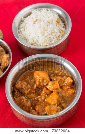 Indo-Chinese chili garlic chicken, a North Indian fusion food from Kolkata, with rice