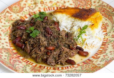 Iranian (Persian) herb and lamb koresh served with Persian saffron rice. The meat is slowly stewed with masses of parsley, coriander and scallions.