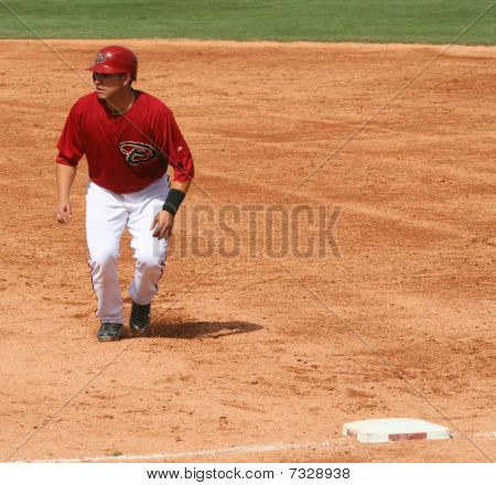 Miguel Montero retreats to first base