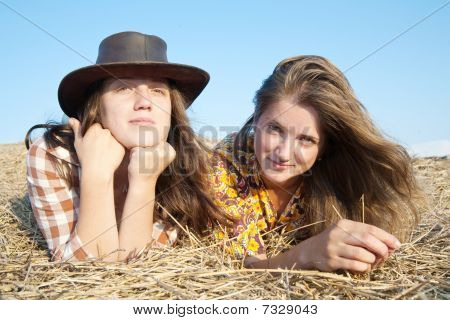 Girls Laying In Hay