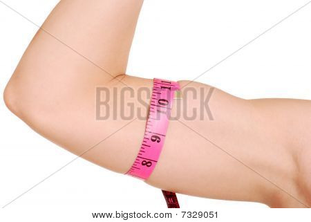 female arm with tape measure around bicep