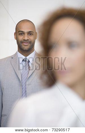 African businessman behind coworker