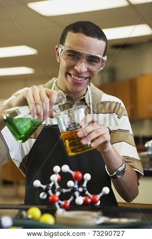 Mixed Race teenaged boy in science class