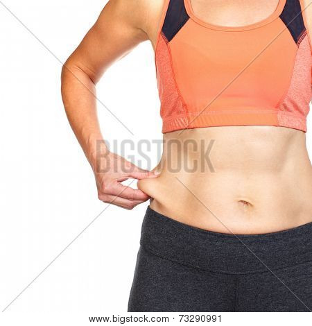 Female body fat on her abdomen. Weight loss diet and health.
