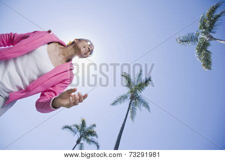 Mixed Race woman under palm trees