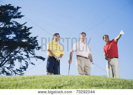 Multi-ethnic men on golf course