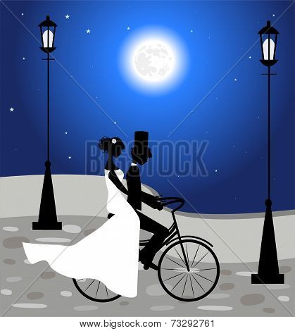 Wedding couple ride a bicycle