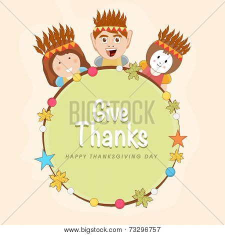 Cute little happy Indian American kids holding wishing message Give Thanks on occasion of Thanksgiving Day celebrations.