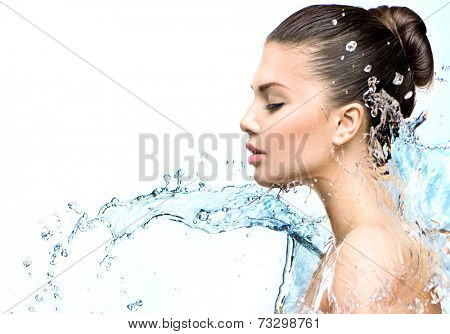 Beautiful Model Woman with splashes of water in her hands. Beautiful Smiling girl under splash of water with fresh skin on white background. Skin care, Cleansing and moisturizing concept. Beauty face