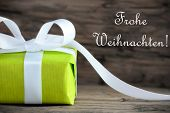 stock photo of weihnachten  - Green Christmas Gift with the German Words Frohe Weihnachten which means Merry Christmas - JPG