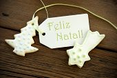 stock photo of natal  - The Portuguese Words Feliz Natal which means Merry Christmas on a Label with Christmas Cookies - JPG
