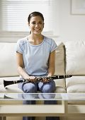 pic of clarinet  - Asian girl holding clarinet - JPG
