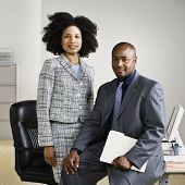 stock photo of chums  - African American businesspeople in front of desk - JPG