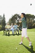 picture of foursome  - Asian woman playing golf - JPG