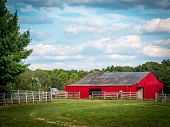 stock photo of red barn  - Red barn tucked within a country surrounding in south - JPG
