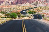stock photo of valley fire  - A road runs through it in the Valley of Fire State Park near Las Vegas Nevada - JPG