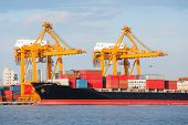 foto of container ship  - Cargo ship unloading container at port day time - JPG