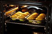 picture of chocolate muffin  - baking banana and chocolate muffins in oven - JPG
