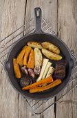 picture of parsnips  - roasted carrot parsnip onion garlic potato and pumpkin in cast iron pan - JPG