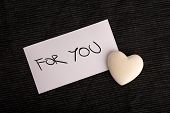image of heartfelt  - For You Written on White Card with White Heart as seen from Above - JPG
