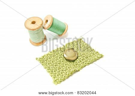 Wooden Spools Of Thread And Button