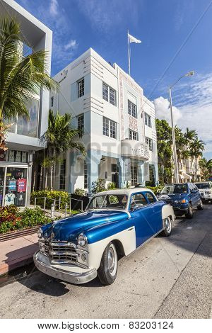 The Art Deco District In Miami And A Classic Oldsmobile Car