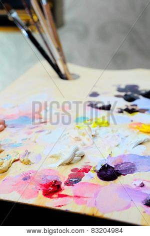 art paint palette with brushes and paints