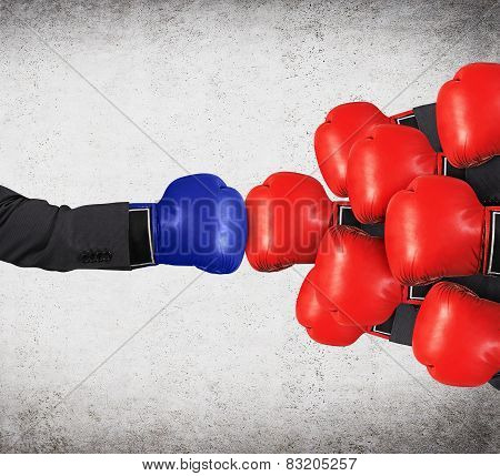 Hands In Red And Blue Gloves