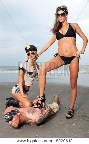 Two Female Models On The Beach Arrest A Guy With Tattoos